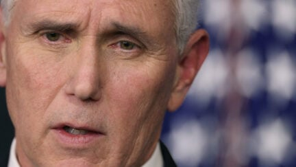 Close up on Mike Pence's consternated face.