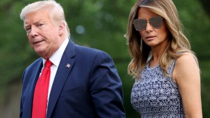 Donald and Melania Trump walk outside.