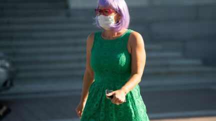 US Senator Kyrsten Sinema (D-AZ) wearing a mask to protect herself and others from COVID-19, known as coronavirus, leaves following a vote at the US Capitol in Washington, DC, May 4, 2020. (Photo by SAUL LOEB / AFP) (Photo by SAUL LOEB/AFP via Getty Images)