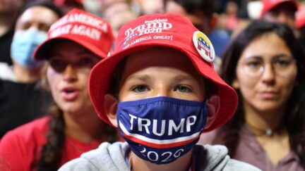 A young supporter wears a Trump 2020 mask at Trump's Tulsa rally.