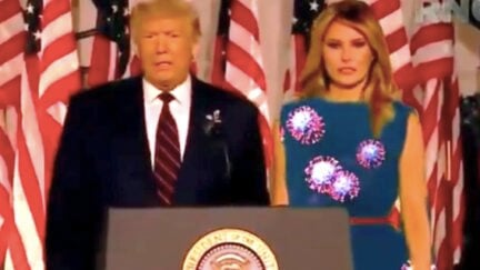 Melania Trump green screen dress with coronavirus put on it.