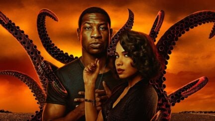 Letitia and Atticus stand together, with tentacles reaching out behind them, in poster art for HBO's Lovecraft Country.