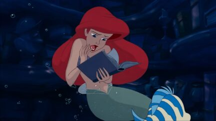 ariel looking at a book
