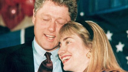 WASHINGTON, : A 1992 photo shows then Governor of Arkansas Bill Clinton (L) and his wife Hillary (R) embracing. Clinton has been accused of having an affair with a former White House intern, Monica Lewinsky, and during a depostion 17 January in the Paula Jones sexual harrassment suit, he admitted to having a relationship with Gennifer Flowers when he was governor. (Photo credit should read AFP/AFP via Getty Images)