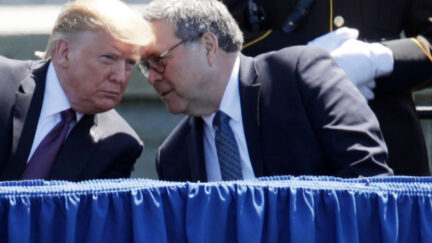 Donald Trump listens as Attorney General William Barr speaks into his ear.