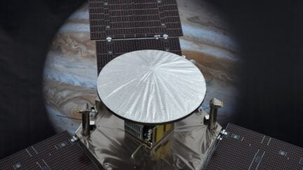 A 1/4 scale model of NASA's Juno Spacecraft is seen in front of an image of Jupiter, at the Jet Propulsion Laboratory (JPL) in Pasadena, California, July 3, 2016. NASA's solar-powered Juno spacecraft is scheduled to enter into orbit around Jupiter on July 4 to begin an in-depth study of the planet's formation, evolution and structure. The key event on July 4 is a 35-minute engine burn at 11:18 p.m. EDT (0318 GMT on Tuesday), which is designed to slow Juno down enough to be captured by Jupiter's powerful gravity. / AFP / Robyn Beck (Photo credit should read ROBYN BECK/AFP via Getty Images)