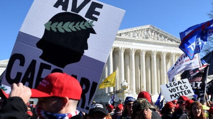 Supporters of US President Donald Trump rally at the US Supreme Court in Washington, DC, on November 14, 2020. - Supporters are backing Trump's claim that the November 3 election was fraudulent. (Photo by Olivier DOULIERY / AFP) (Photo by OLIVIER DOULIERY/AFP via Getty Images)