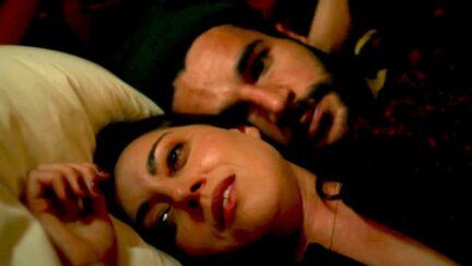Aubrey Plaza's Allison lying down next to Gabe in Black Bear.