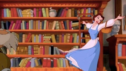 Belle singing on a ladder on a book shelf in Disney's Beauty and the Beast.