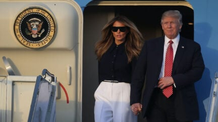 Donald and Melania Trump exit Air Force One
