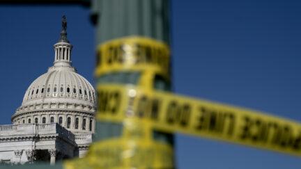 Police tape hangs near the U.S. Capitol