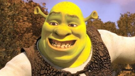 Shrek smiling unconvincingly in Shrek.