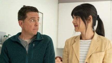 Patti Harrison and Ed Helms pull faces at each other in Together Together.