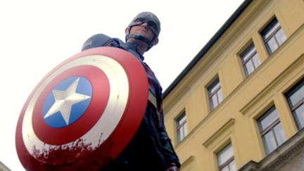 Wyatt Russell holds a bloody Captain America shield as John Walker on the Falcon and the Winter Soldier