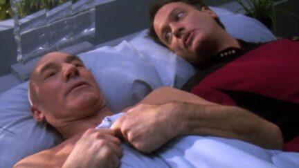 John de Lancie as Q and Patrick Stewart as Picard