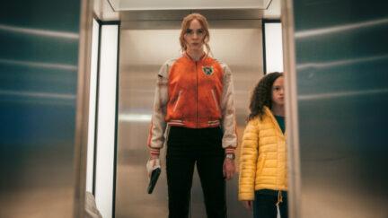 Karen Gillan and Chloe Coleman standing in an elevator in Gunpowder Milkshake