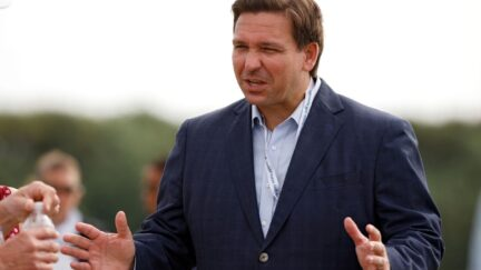 Gov. Ron DeSantis with fans during Day One of the Walker Cup at Seminole Golf Club.