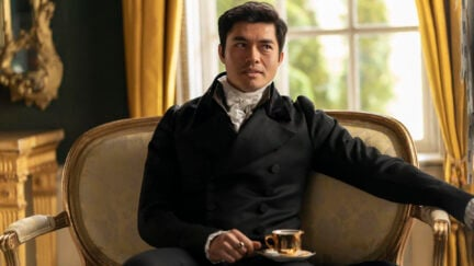 Henry Golding in a cravat