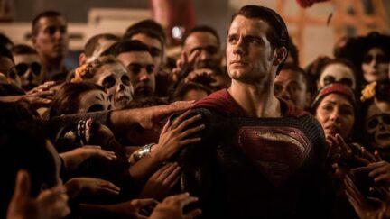 Superman with people flocking around him like a messianic figure on Batman v Superman.