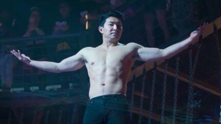 Simu Liu shirtless, shrugging as Marvel's Shang-Chi.