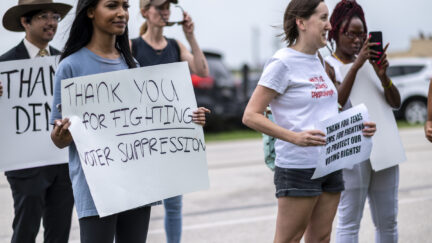Supporters for Texas Democrats stand outside the Austin Bergstrom International Airport on July 12, 2021