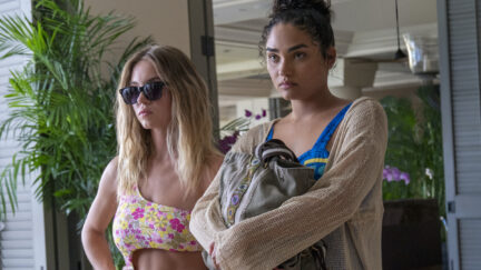 Olivia and Paula stand glaring in a scene from The White Lotus