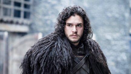 kit harington in a fur cloak as jon snow in game of thrones