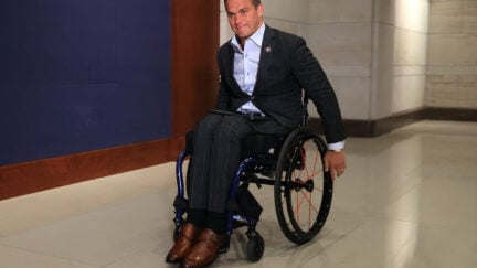 Madison Cawthorn in his wheelchair in a hallway of the Capitol
