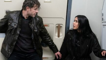 Josh Dallas and Parveen Kaur as Ben and Saanvi soaked on a plane on 'Manifest'
