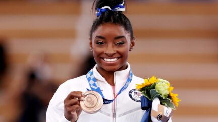 TOKYO, JAPAN - AUGUST 03: Simone Biles of Team United States poses with the bronze medal during the Women's Balance Beam Final medal ceremony on day eleven of the Tokyo 2020 Olympic Games at Ariake Gymnastics Centre on August 03, 2021 in Tokyo, Japan. (Photo by Jamie Squire/Getty Images)