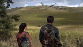 Pedro Pascal and Bella Ramsey looking out at a field in HBO's The Last of Us