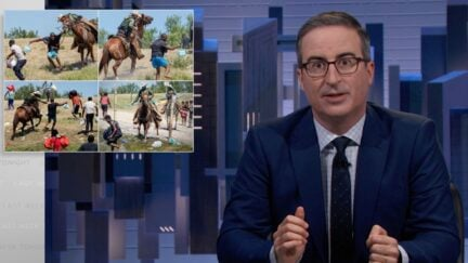 John Oliver sits at his news desk, shows pictures of border patrol assaulting Haitian refugees during a segment on Last Week Tonight