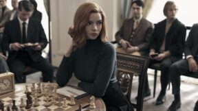 The Queen's Gambit still of her thinking at a chess set. (Image: Netflix.)