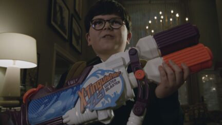 Archie Yates holding a toy gun in the trailer for Home Sweet Home Alone
