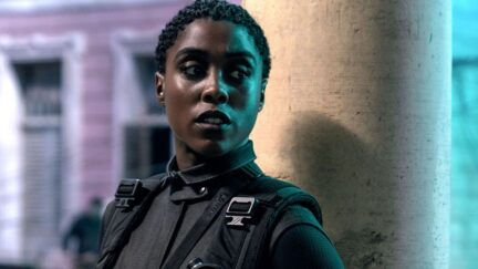 Lashana Lynch as Nomi standing against a pillar in No Time To Die
